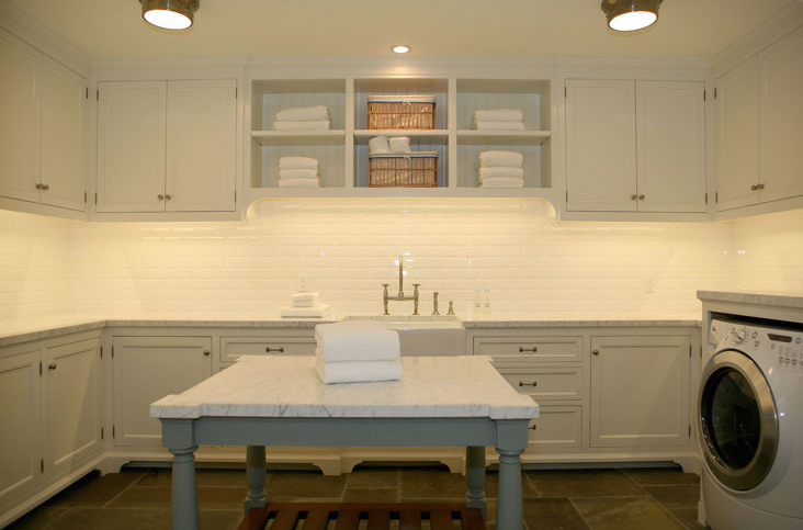 suzie giannetti home chic large 2nd floor laundry room design with white cabinets