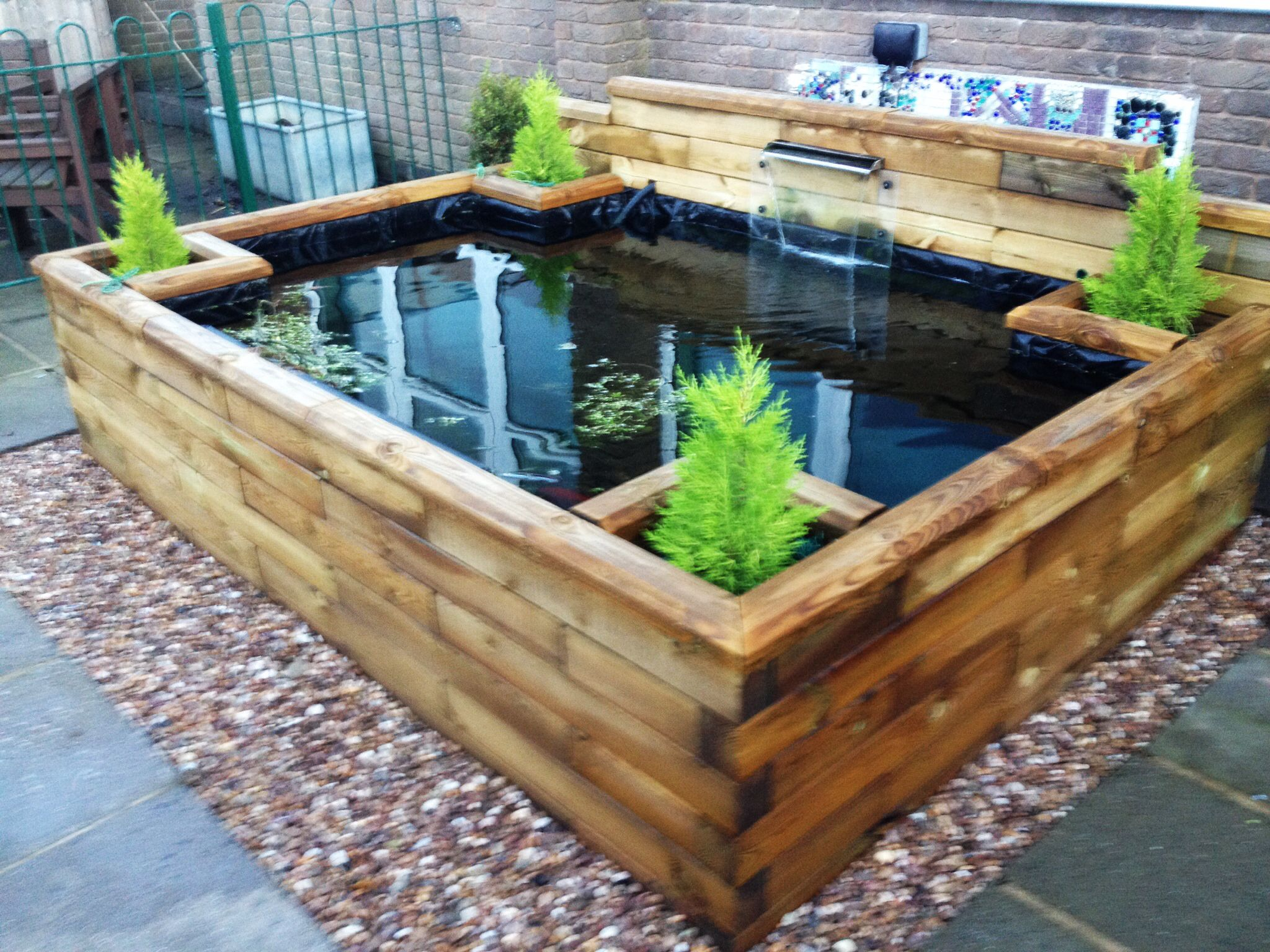 This customer has cleverly added a water blade feature to for Diy raised pond ideas