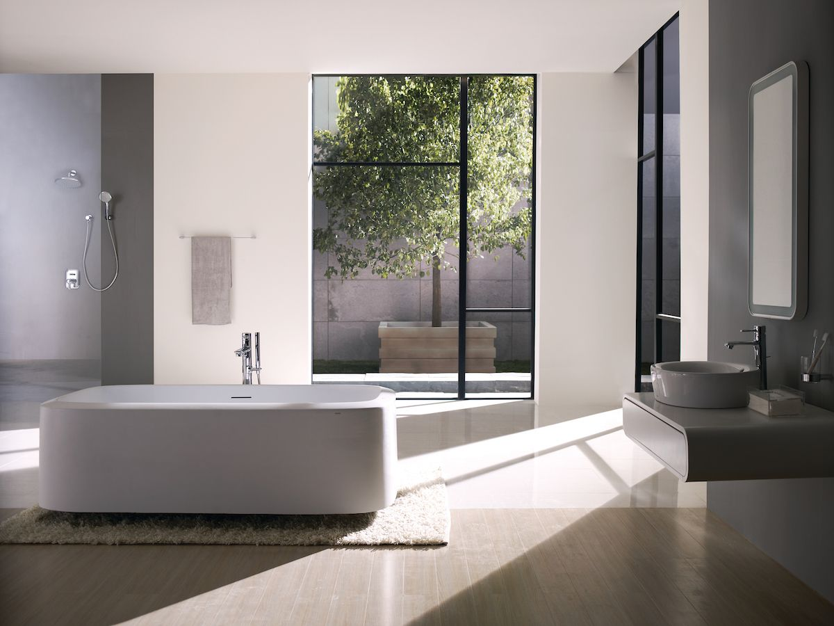 Steel Window Frame Paired With A Sleek Toto Freestanding Tub