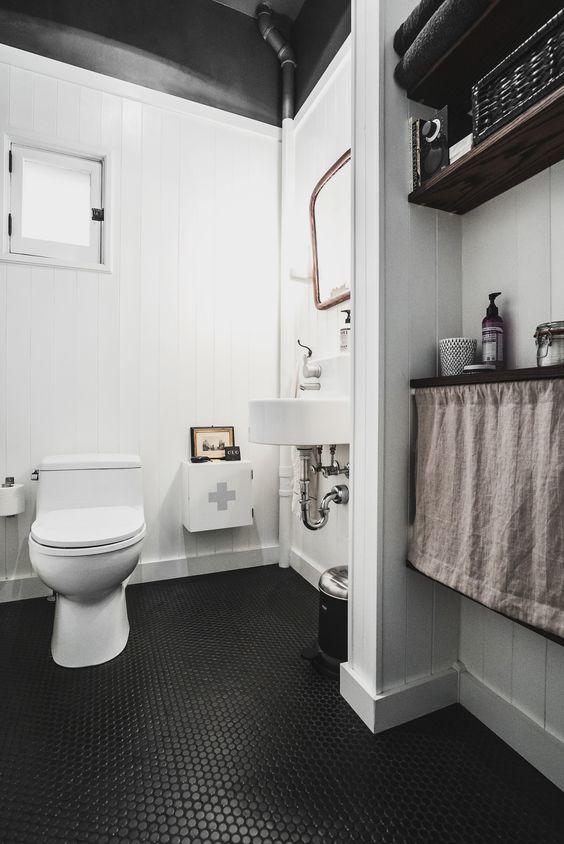 Monochromatic Bathroom With Black Penny Tiles On The Floor Monochromatic Bathroom Black Bathroom Floor Black Floor Tiles