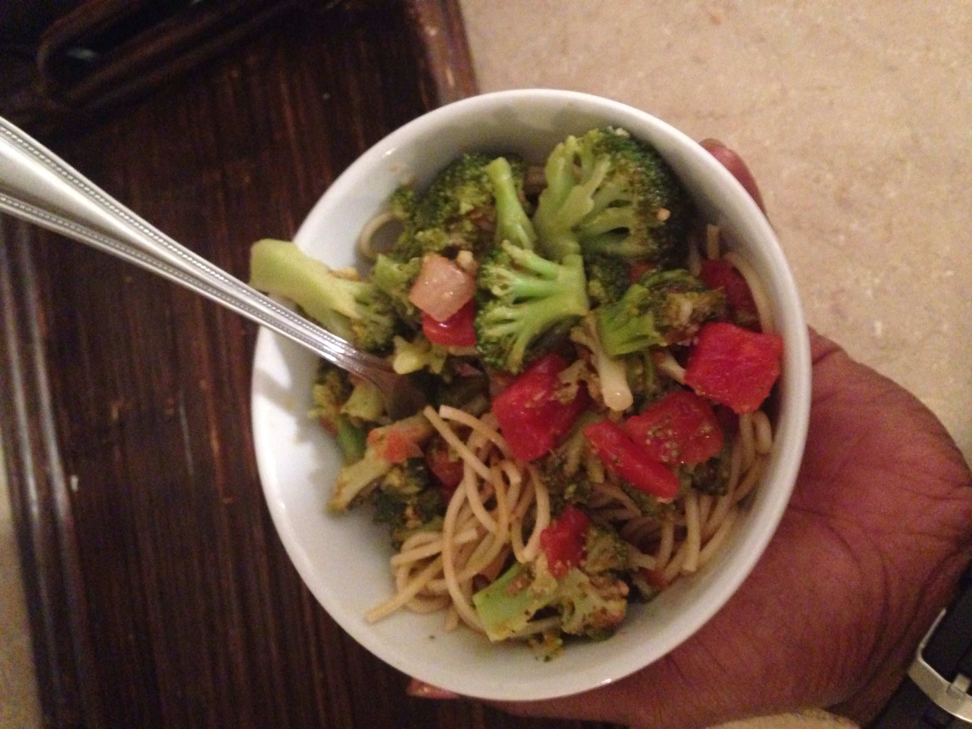A vegetarian post workout meal... Sautéed tomato broccoli and wheat noodles! Yum