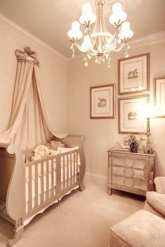 Elegant Babys Nursery with Mirrored Furniture and Sleigh Crib