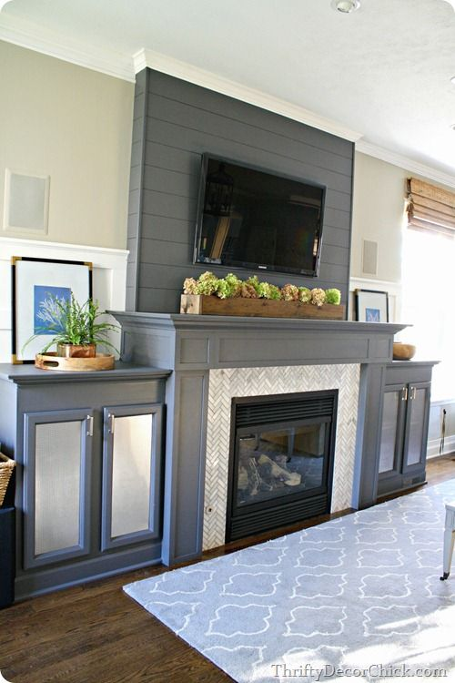 A gorgeous gray gas #fireplace complete with #DIY built ins and a #DIY plank wall ...