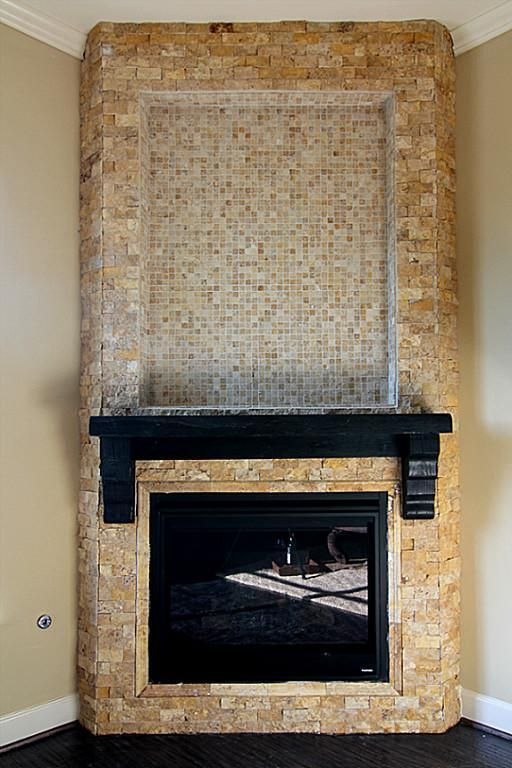 Interesting Fireplace Finish Mix Of Stone And Smaller