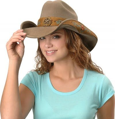 c9470f06a Young woman wearing cowboy hat | Styles I love | Womens health ...