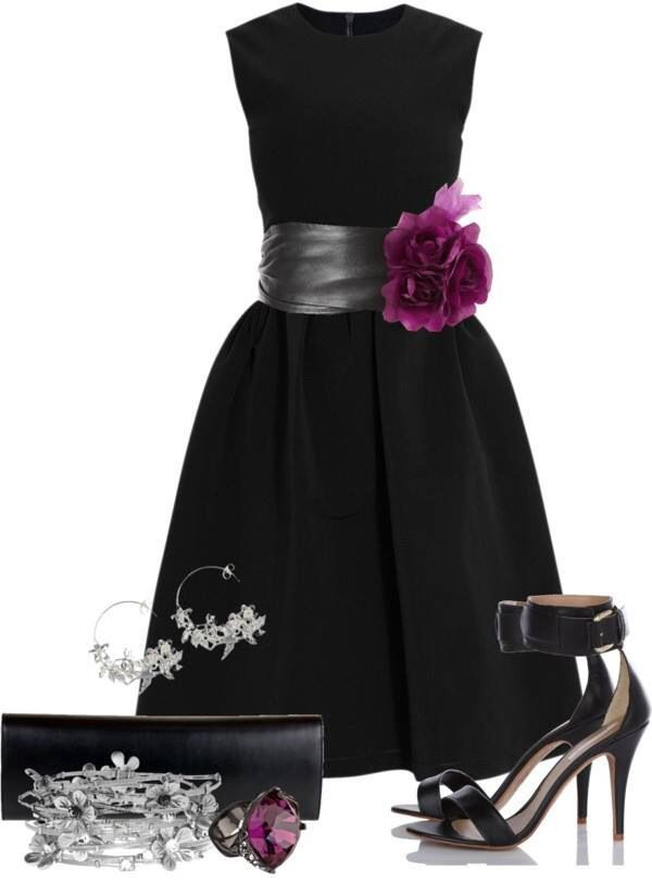 Love it - a splash of purple (amethyst ring and nosegay of flowers) Wide, leather cumerbund belt. Otherwise, simple black dress; sleeveless, with jeweled neckline and full skirt