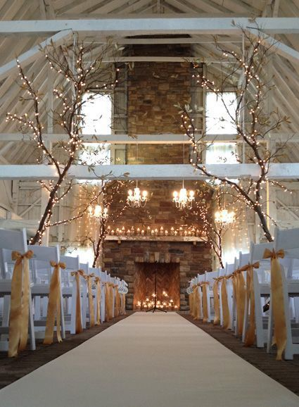 b8925c740acf8c Stunning wedding venue made with tree decorations  fairy lights and  fireplace focal point using wood and stones - the natural effect!