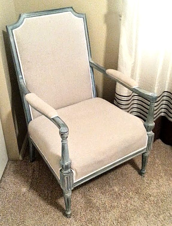 This was an old brown broken chair with floral upholstery. I painted the frame Aqua with whitewash highlights and a combo of dark and clear soft wax to finish and covered in calico fabric with white braid.