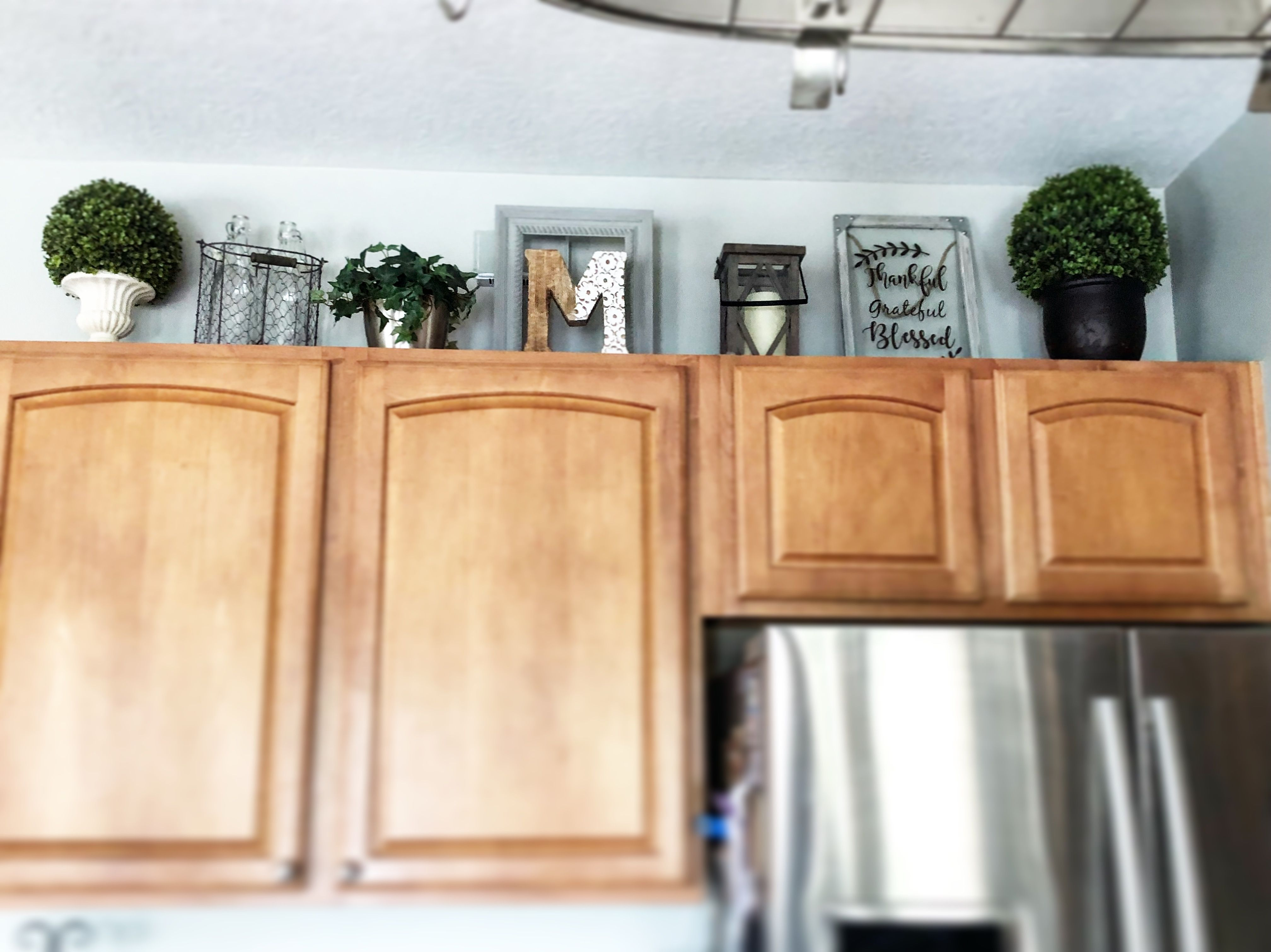 Decorating above the cabinets is so tricky. I tried to add ...