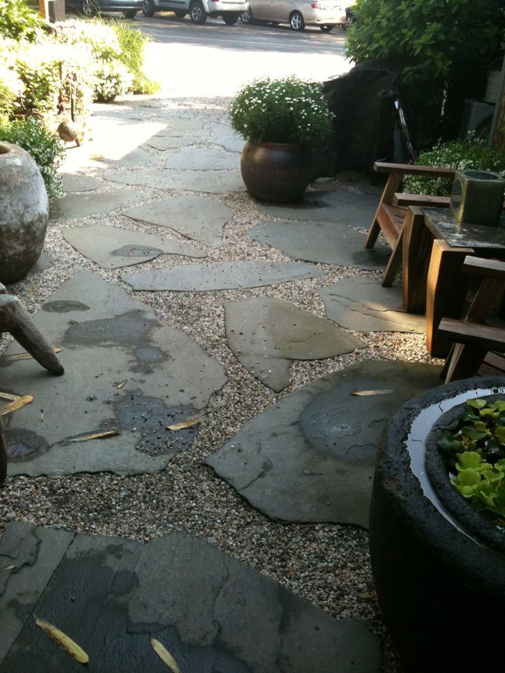 Stepping Stones Love the flagstone but goodness! These big boys can break your back installing or your bank account if you hire a contractor to do #flagstonepathway