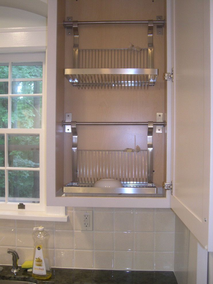 I had the bottom of a standard wall cabinet cut out and for Kitchen drying rack ikea