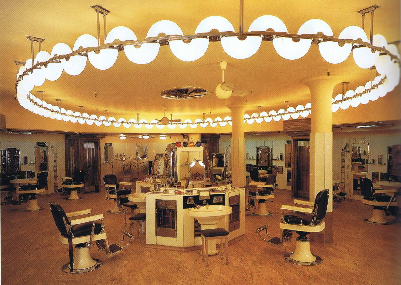 The Barber Shop In The Austin Reed Store In London S Regent Street Featuring Vitrolite Chrome Marble Frosted Glass And Suspended Arcs Of Undulating Neon Tubi