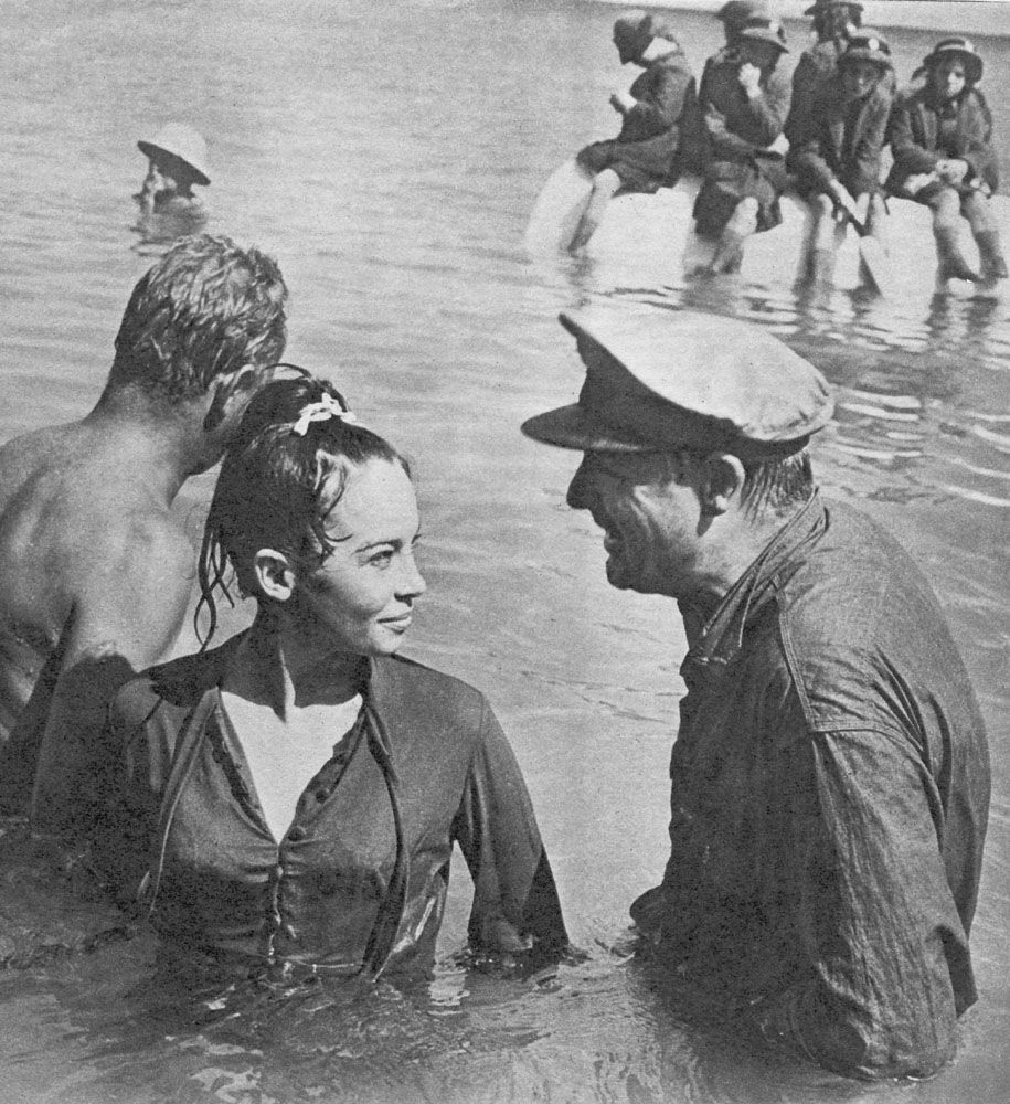 Leslie Caron and Cary Grant during the filming of Father Goose.