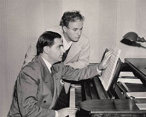 """charlespencerchaplin: """" Charlie Chaplin (standing) with Meredith Wilson working on the score of The Great Dictator (1940). © Chaplin's World by Grévin app. """" At the 13th Academy Awards (honoring movies released in 1940), held at the Biltmore Hotel in..."""