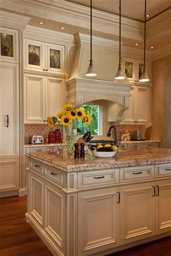 cream color kitchen major crown on soffit creates detail custom home 2996