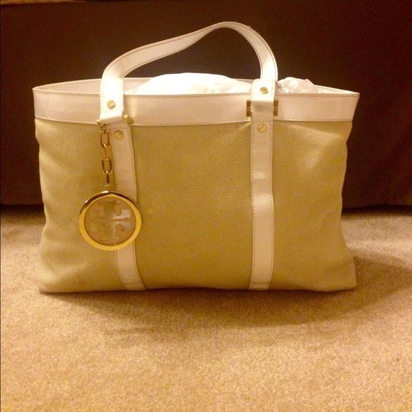 Tory Burch medium size purse Inside pockets with Tory Burch symbol on outside and inside, snap close and beige cloth exterior Tory Burch Bags