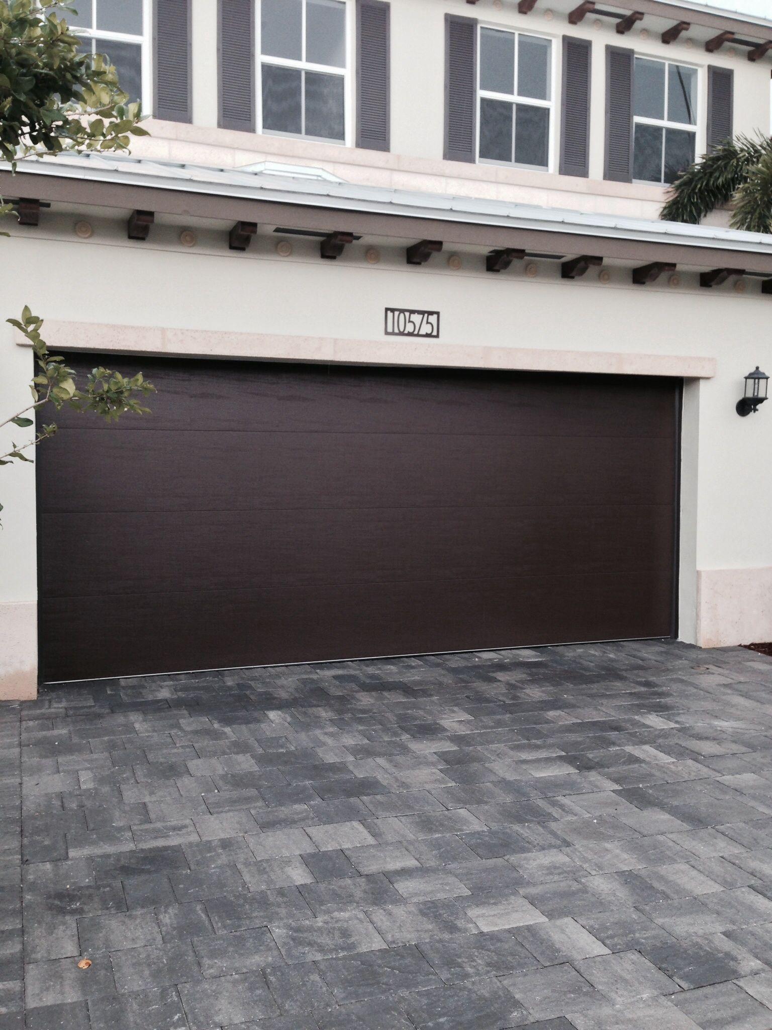 Steel garage door designs - Clopay Steel Garage Door In A Smooth Panel Design Adds A Contemporary Look To This Floroda