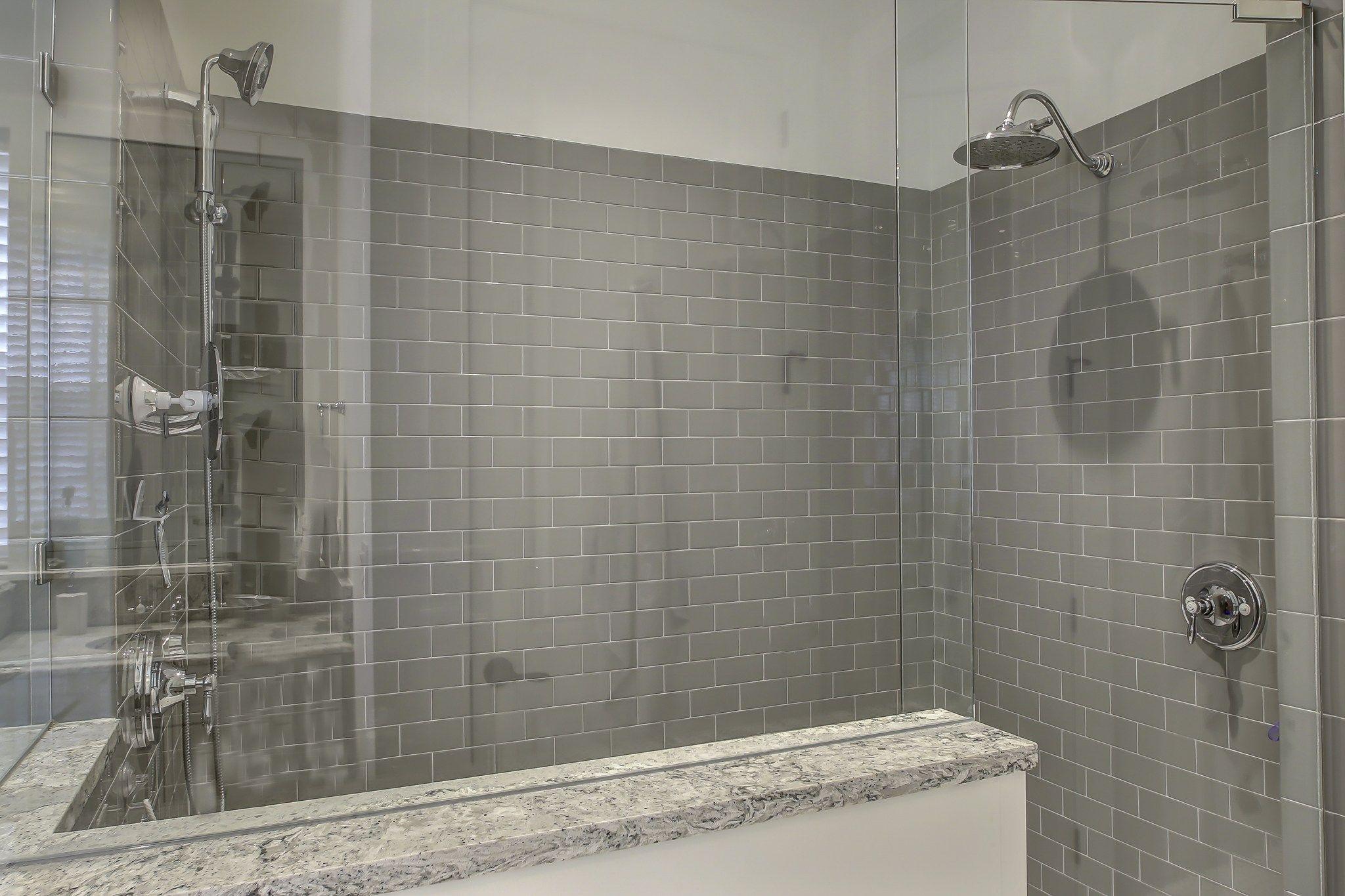 Grey subway tile master shower