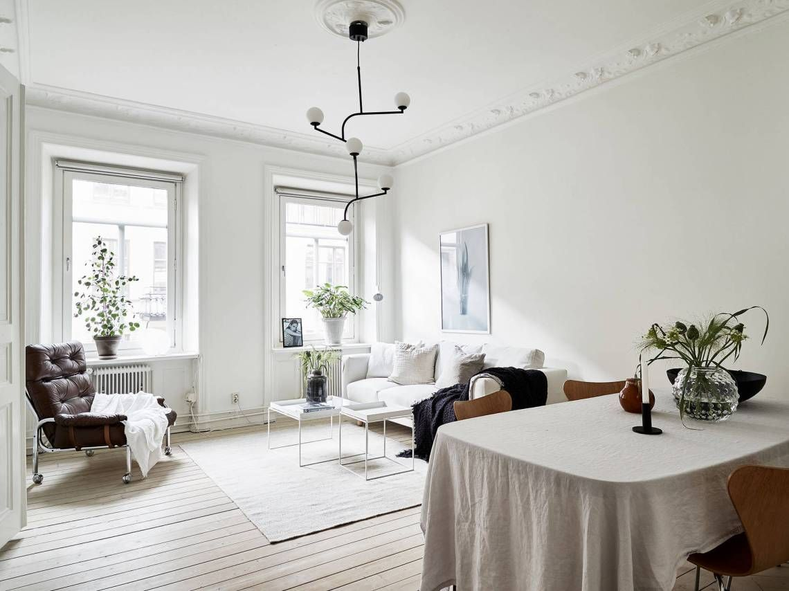 The importance of texture the table cloth fabric sofa and chair blanket add comfort to this fresh and cosy home