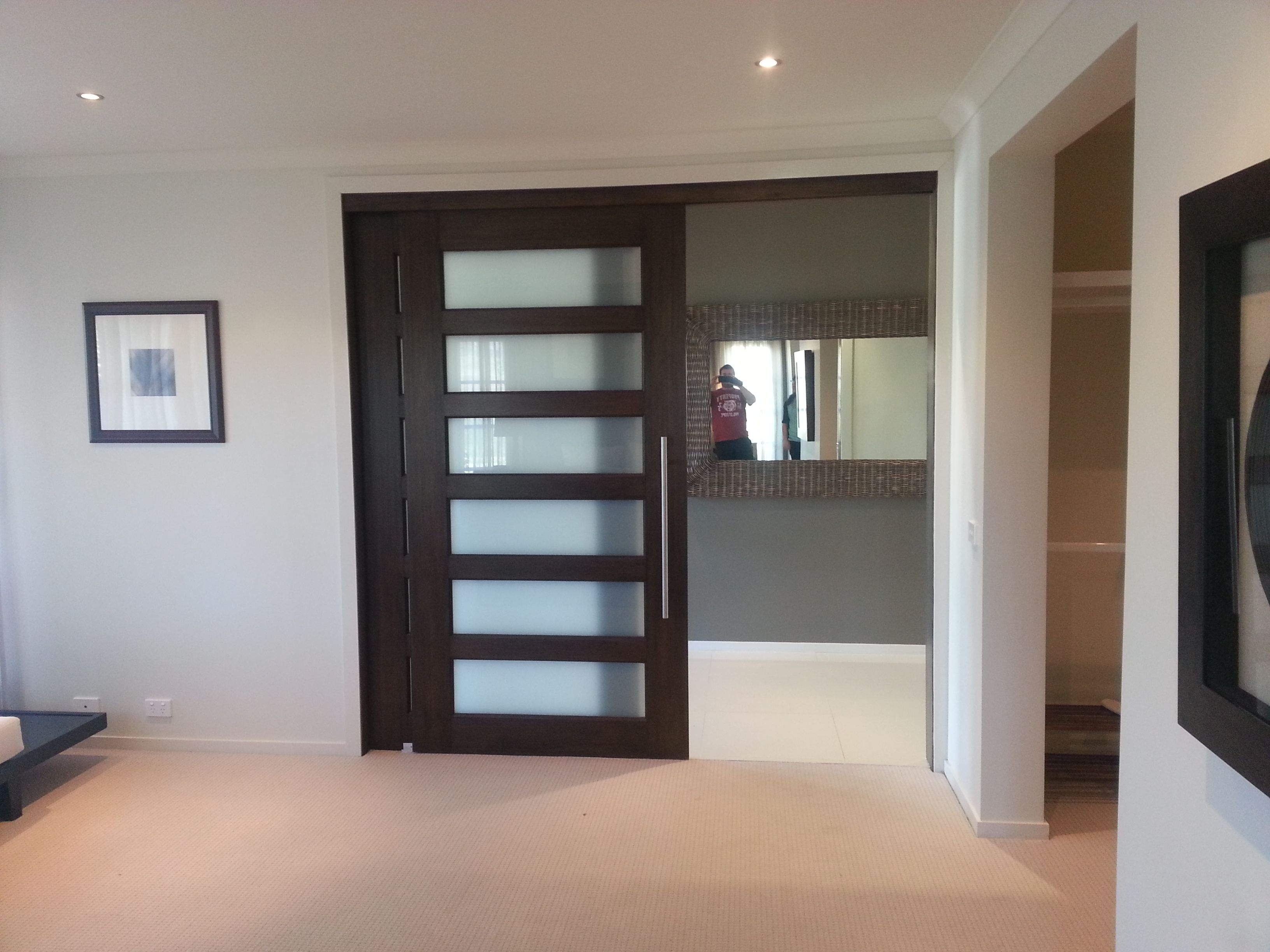 Interior Sliding Door With Opaque Glass Panels From Further Away Sliding Door Bookcase Sliding Glass Door Sliding Doors Interior