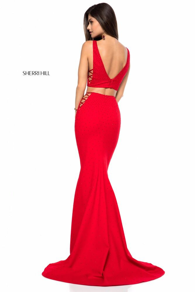 Sexy and chic Sherri Hill two piece prom dress 51840 showcases a low V  neckline crop top and a fitted skirt all adorned in dazzling stones and  edgy side.