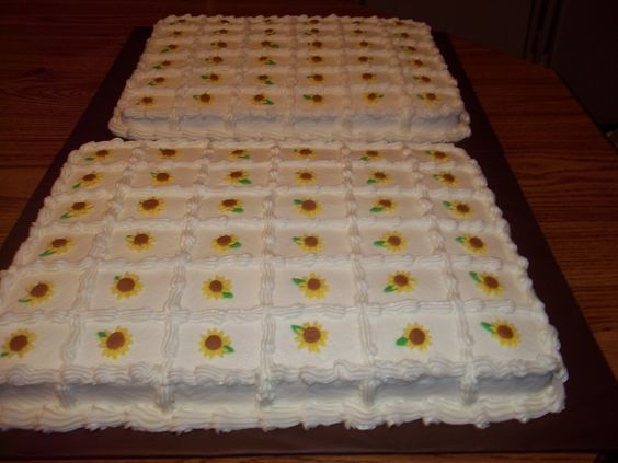cake squares with sunflowers i really dont like these sheet cakes i think it should either be pre cut squares or a cake but the cute little flower