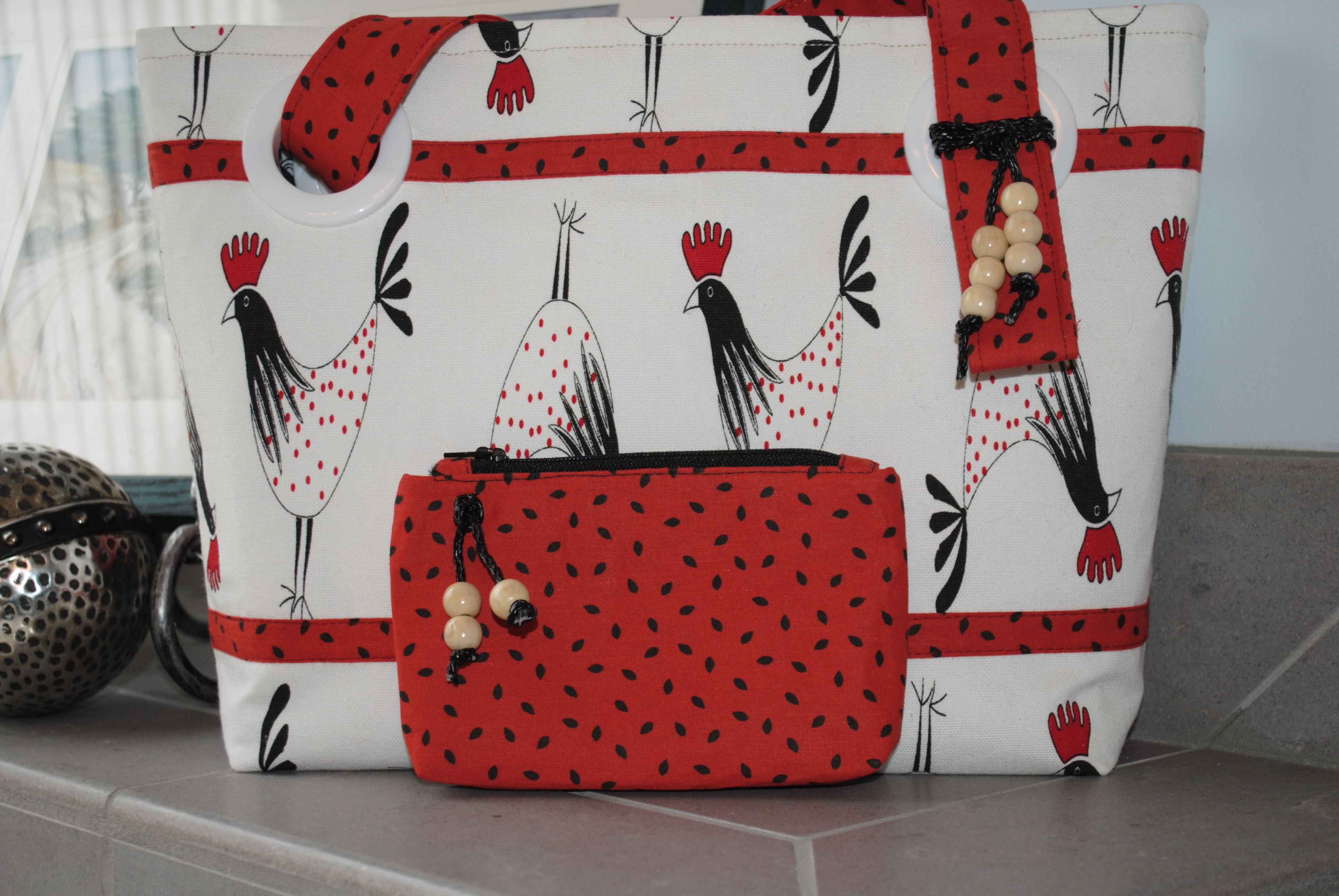 "My new bag named ""Strut!""  Cotton tote purse with marching roosters, contrast trim, fully lined.  Six interior pockets, bonus tiny zippered pouch!  Find Bobbin My Thread on Facebook to see even more of my designs!"