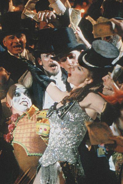 Satine (Nicole Kidman) entertains the gentlemen in Moulin Rouge!.
