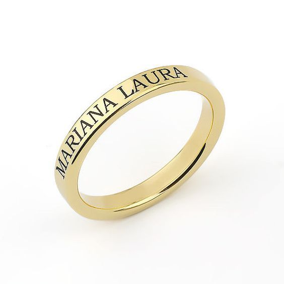 gold ring with name engraved on it