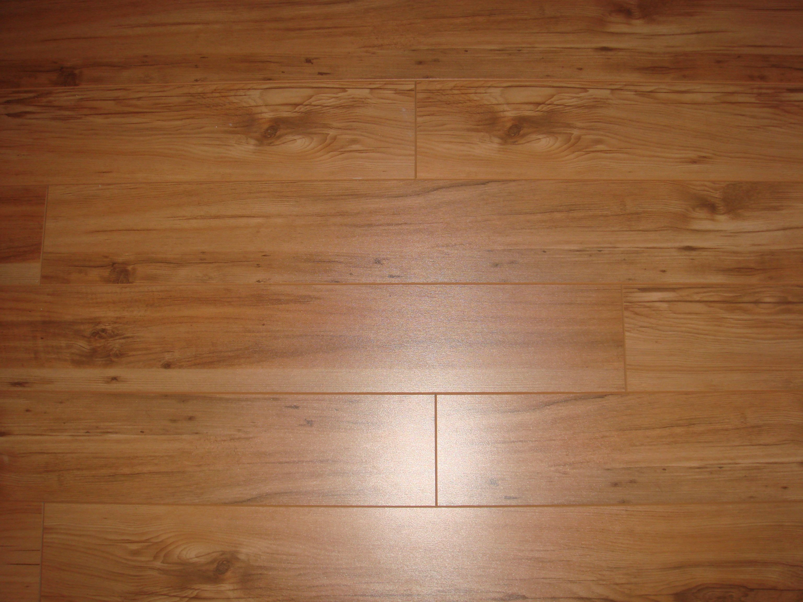 durable laminate flooring is a lowcost option available in styles that mimic stone porcelain tile wood - Wood Tile Flooring