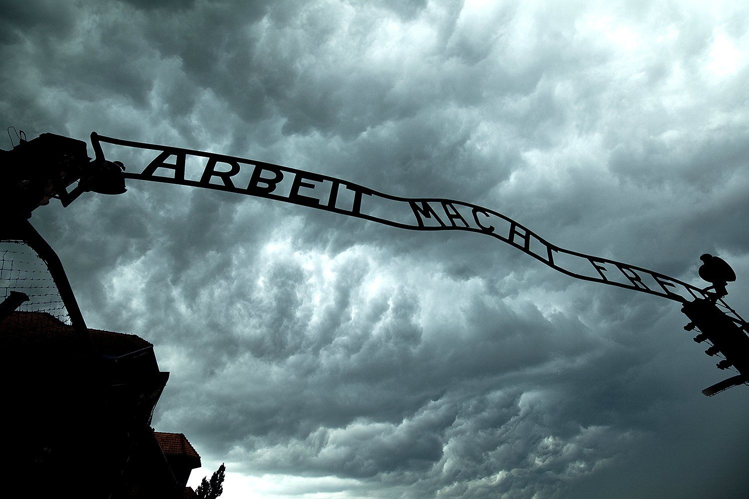 Work shall set you free'.  Entrance sign in Auschwitz concentration camp, Oswiecim, Poland - Jim Zuckerman Photography