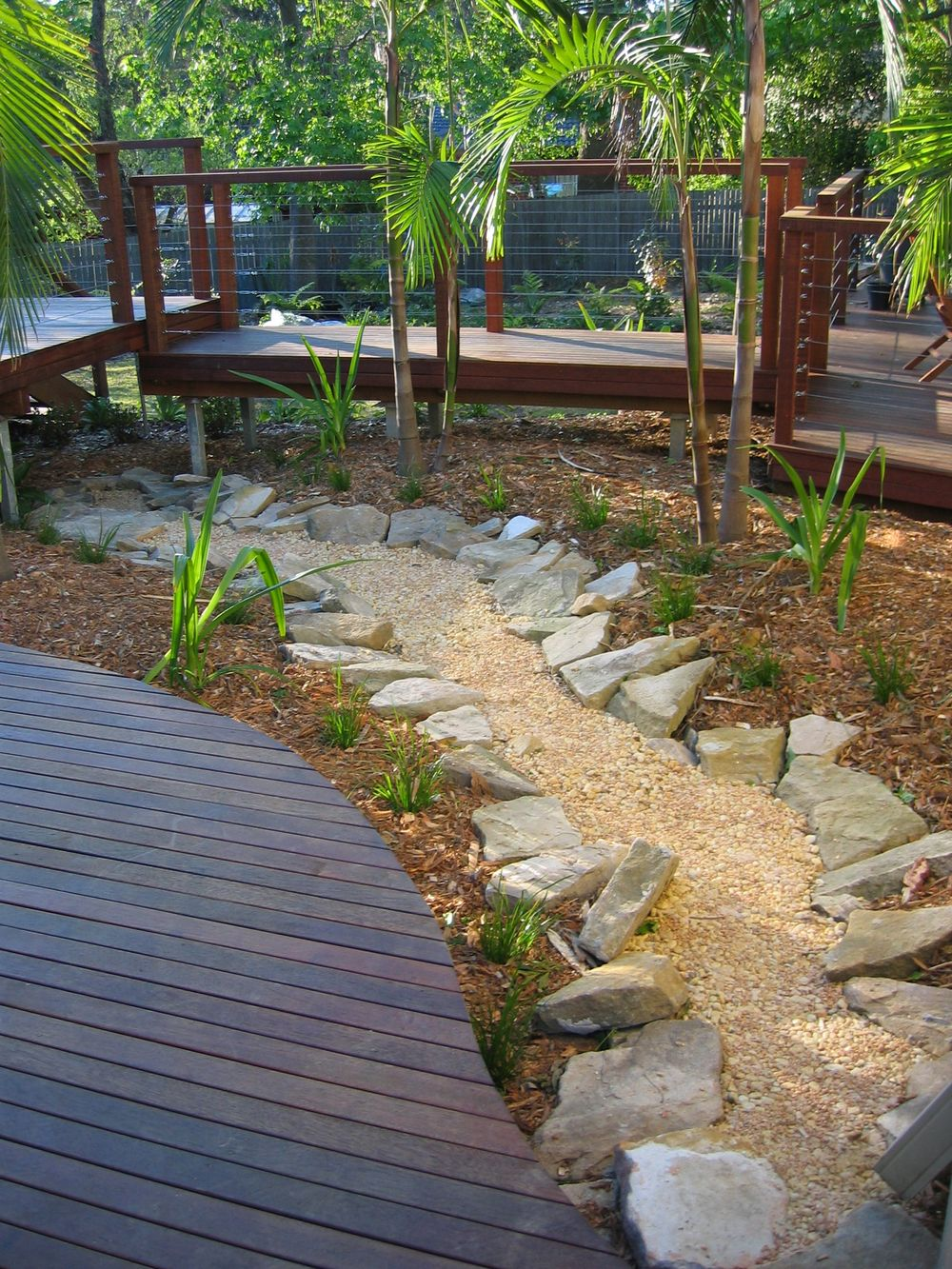 dry creek bed creek stones are too small and uniform use plantings to edge banks not rocks. Black Bedroom Furniture Sets. Home Design Ideas