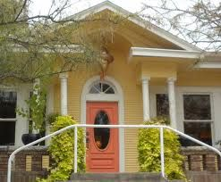 Pastel Yellow House With White Borders And Peach Front Door. SO Cute!