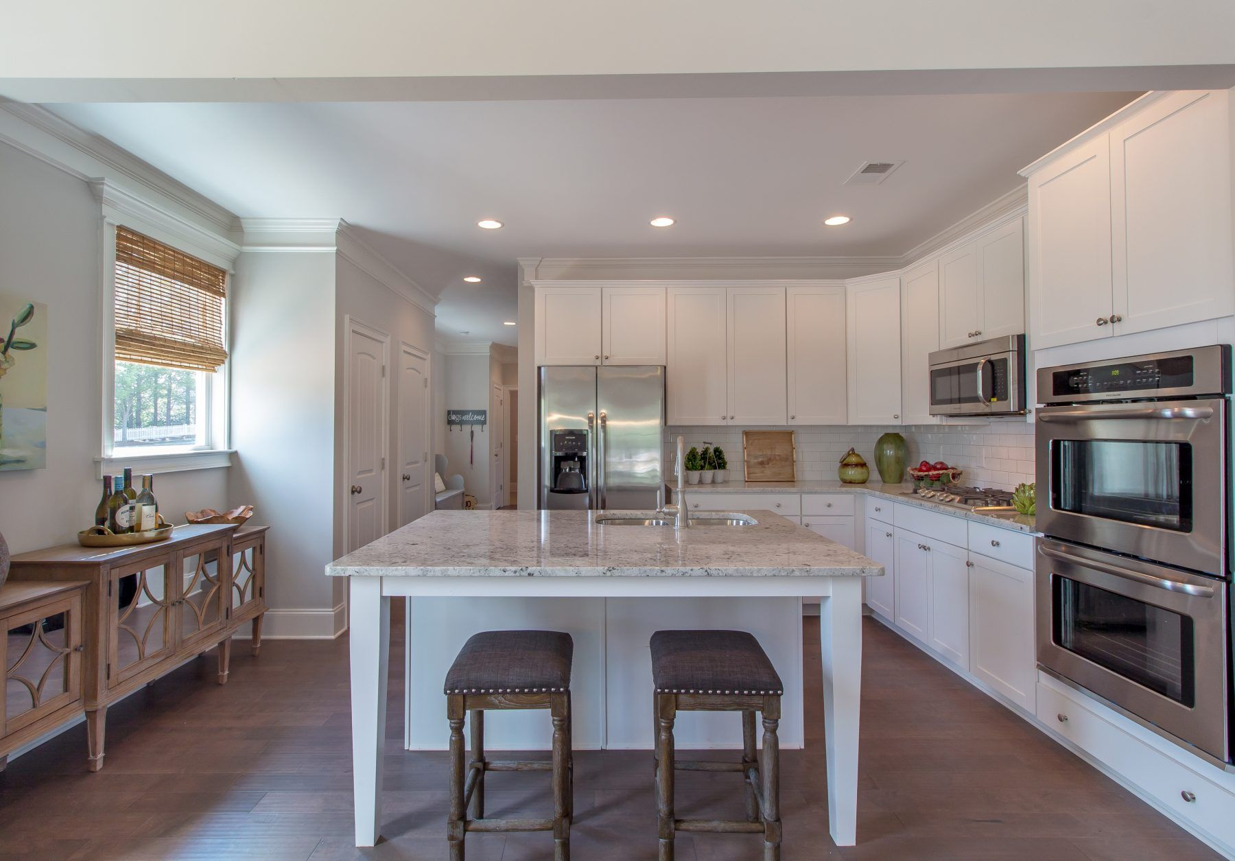 Building kitchen island  Beautiful kitchen island and stainless doulbe ovens  Paran Homes