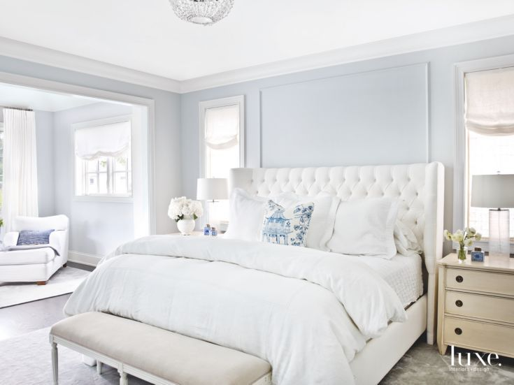 soft light blue master bedroom with blue pillow touches | home