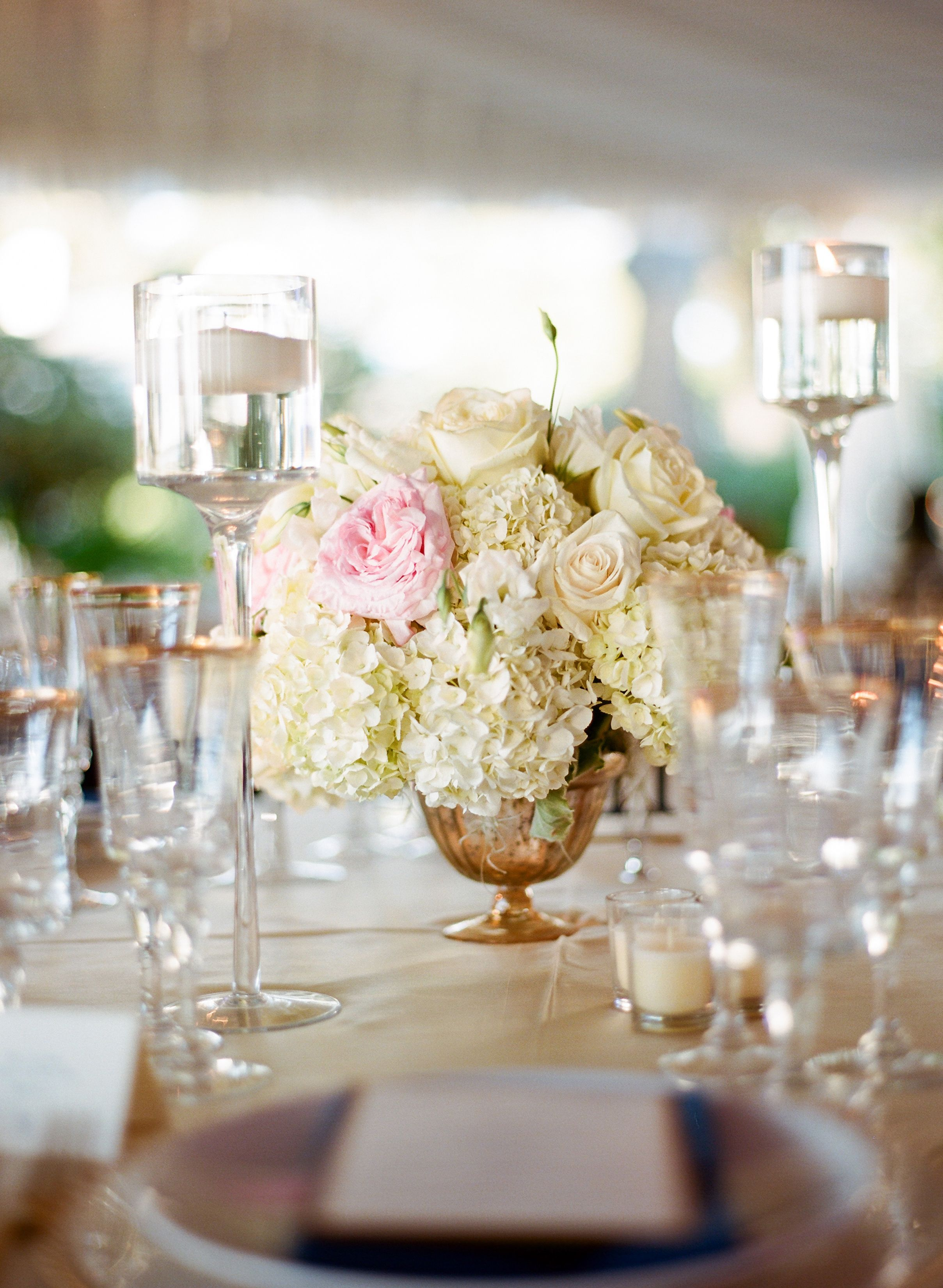 Gold Urn Centerpieces Filled with Ivory Arrangements | WEDDING ...