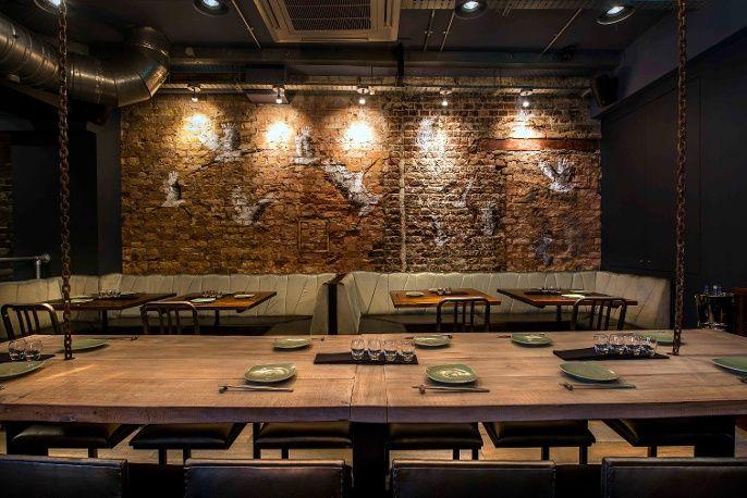 Original brick wall with Korean wall art- fixed seating and back ...