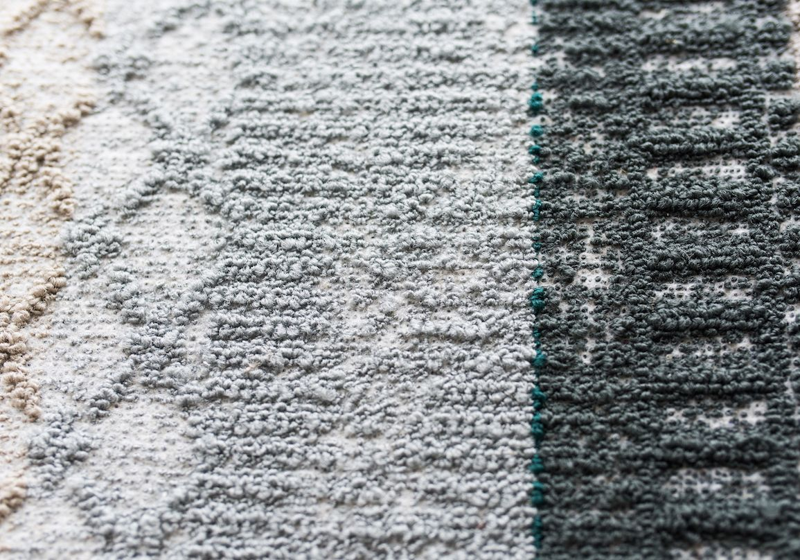Yarn is layered on top of a felted backing to create a soft, slub-like texture in Patcraft's Deconstructed Felt carpet tile collection.