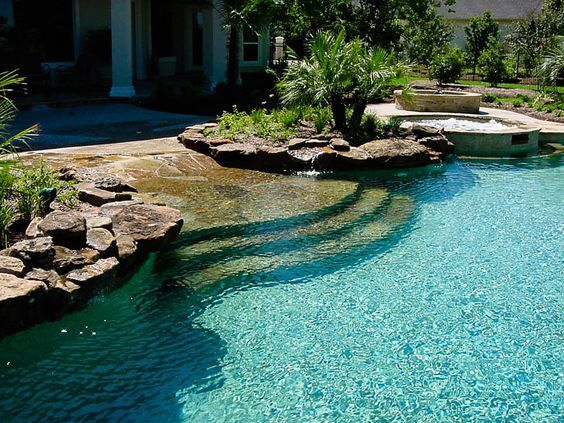 A beach style, walk in pool is gorgeous and makes accessing it easy ...