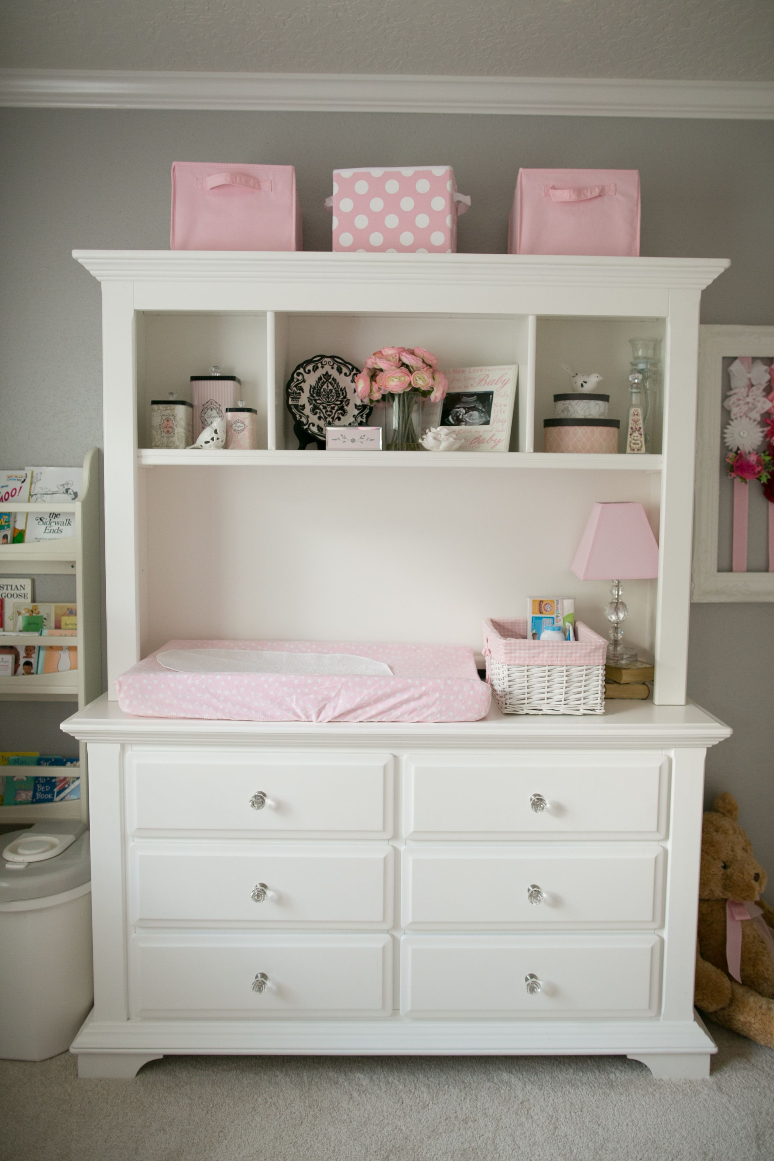 Soft and elegant gray and pink nursery dresser diapers and babies