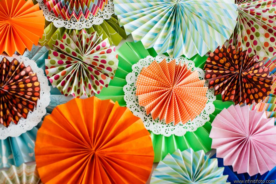 Paper rosettes galore! Colorful backdrop for ceremony or photobooth  Styled shoot by Enamor Events.  http://bridalmusings.com/2012/06/vibrant-and-colourful-1960s-mod-style-palm-springs-elopement-shoot-infiniti-foto/