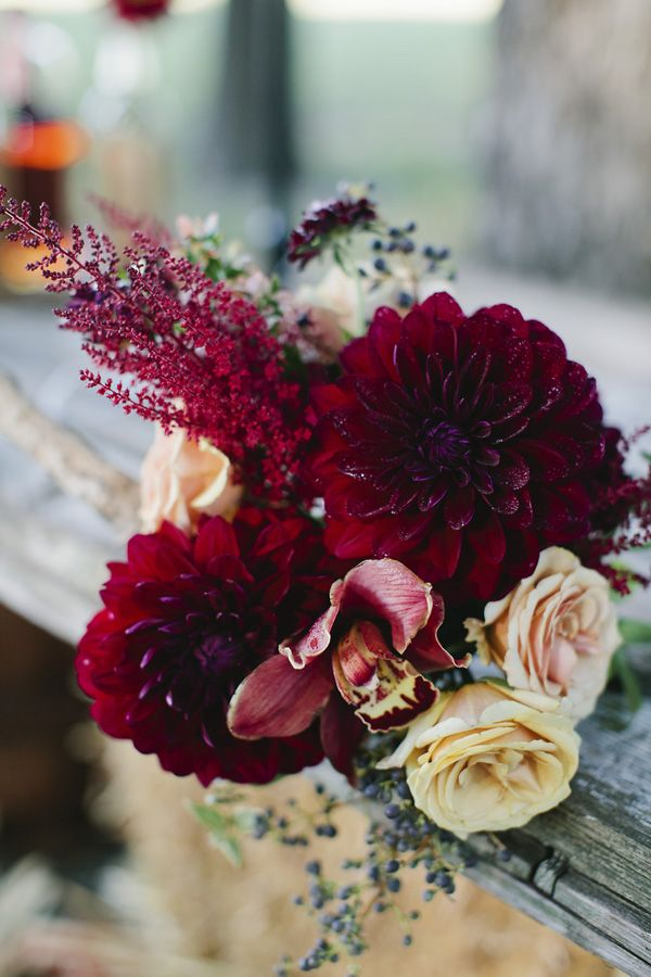 Red dahlias, yellow roses, orchids - fall display