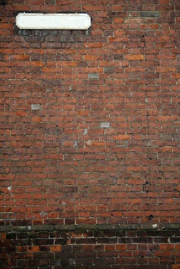 Old fashioned street sign brick wall background. Vintage