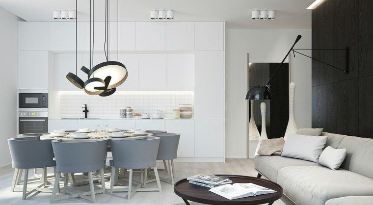 Open space con dei mobili sospesi soggiorno, cucina bianca e ...