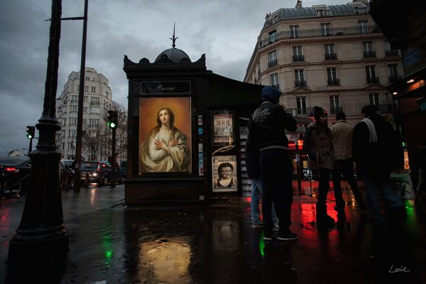 """In a new project called """"OMG, Who Stole My Ads?"""" French street artist Etienne Lavie makes it his mission to transform the ad space in Paris into an outdoor art gallery. He has been travelling around the city, snatching up posters and billboards, and replacing them with fine specimens of French art from an earlier era."""