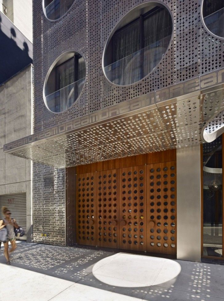 Unique Hotel Building with Metal Panels: Cutting Edge Grey Silver Dream Downtown Hotel Prefabricated Building With Perforated Style For Wall And Wooden Entry Gates ~ relyme.com Hotel & Resort Inspiration