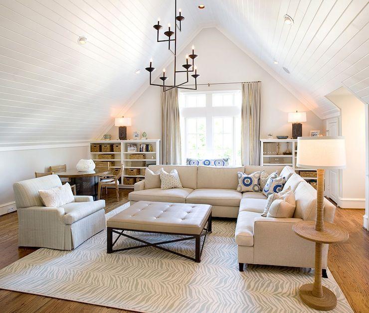 Source Tracy Hardenburg Designs Monochromatic Family Room With Vaulted Ceiling Accented With Beadbo Attic Living Rooms Bonus Room Design Bonus Room Decorating