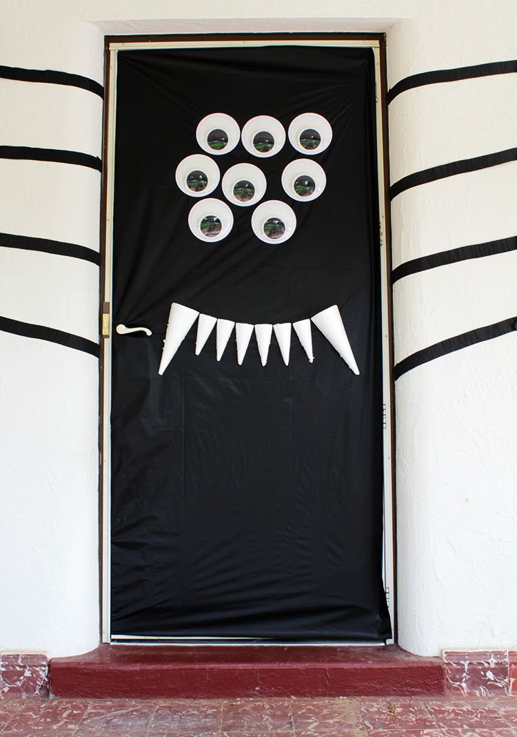 Spider Halloween DIY door decor Halloween from Brit + Co - Halloween Door Decoration Ideas
