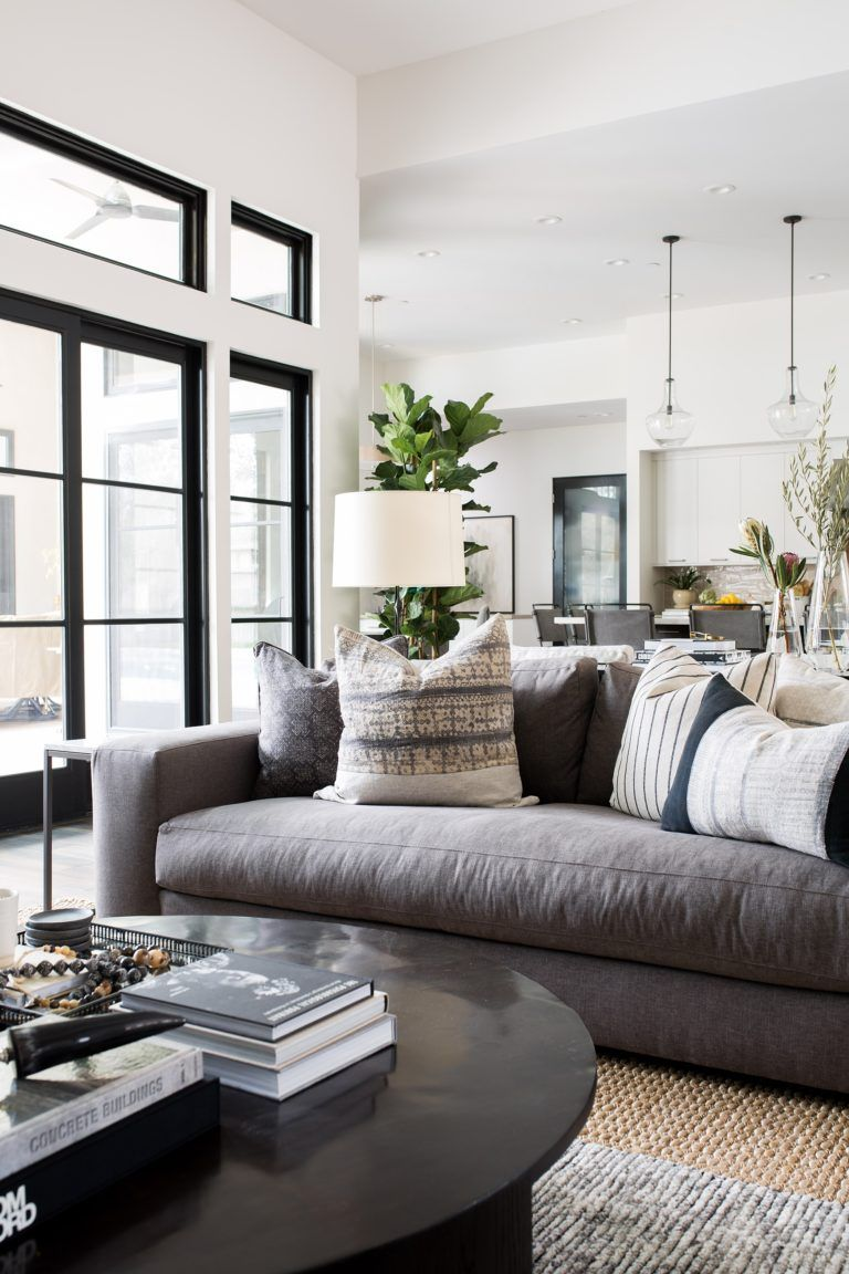 modern living room with gray couch and black round coffee table rh pinterest com