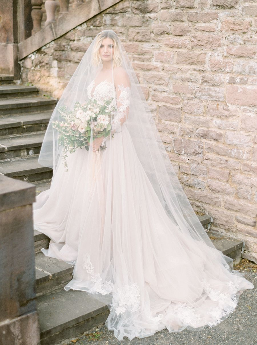 This groom rocked a coral tux weure obsessed veil vaulting and